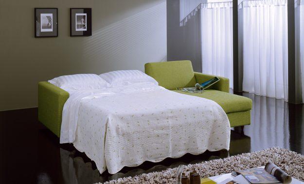 Divano letto con penisola in tessuto